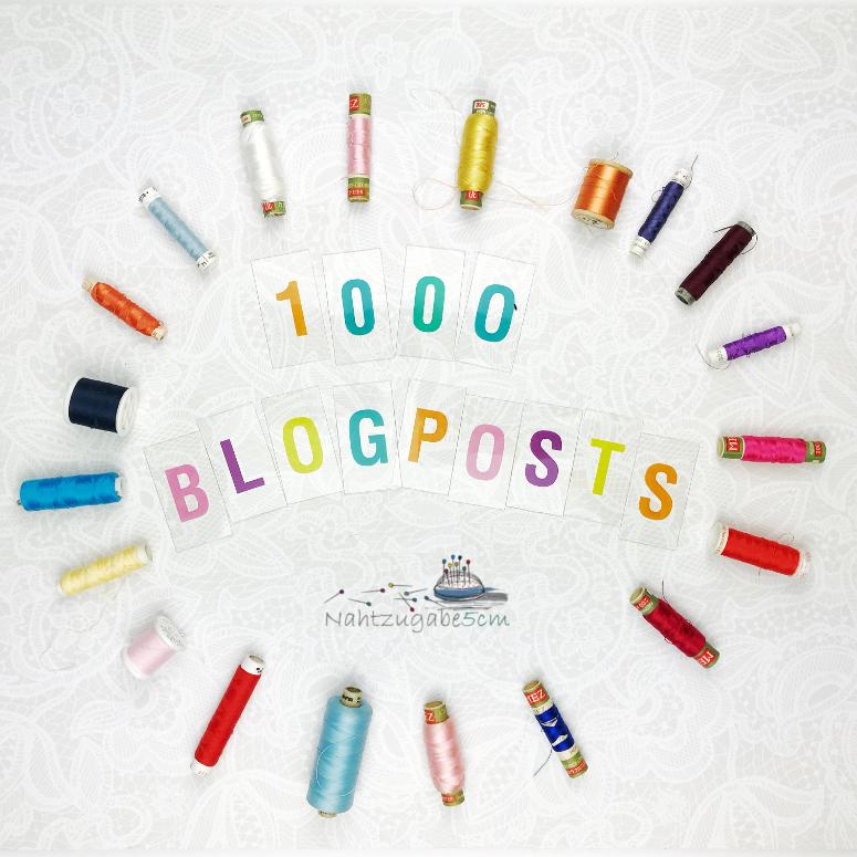 """Logo mit der Beschriftung """"1000 Blogpost Nahtzugabe5cm"""", außenrum liegen farbige Garnrollen"""